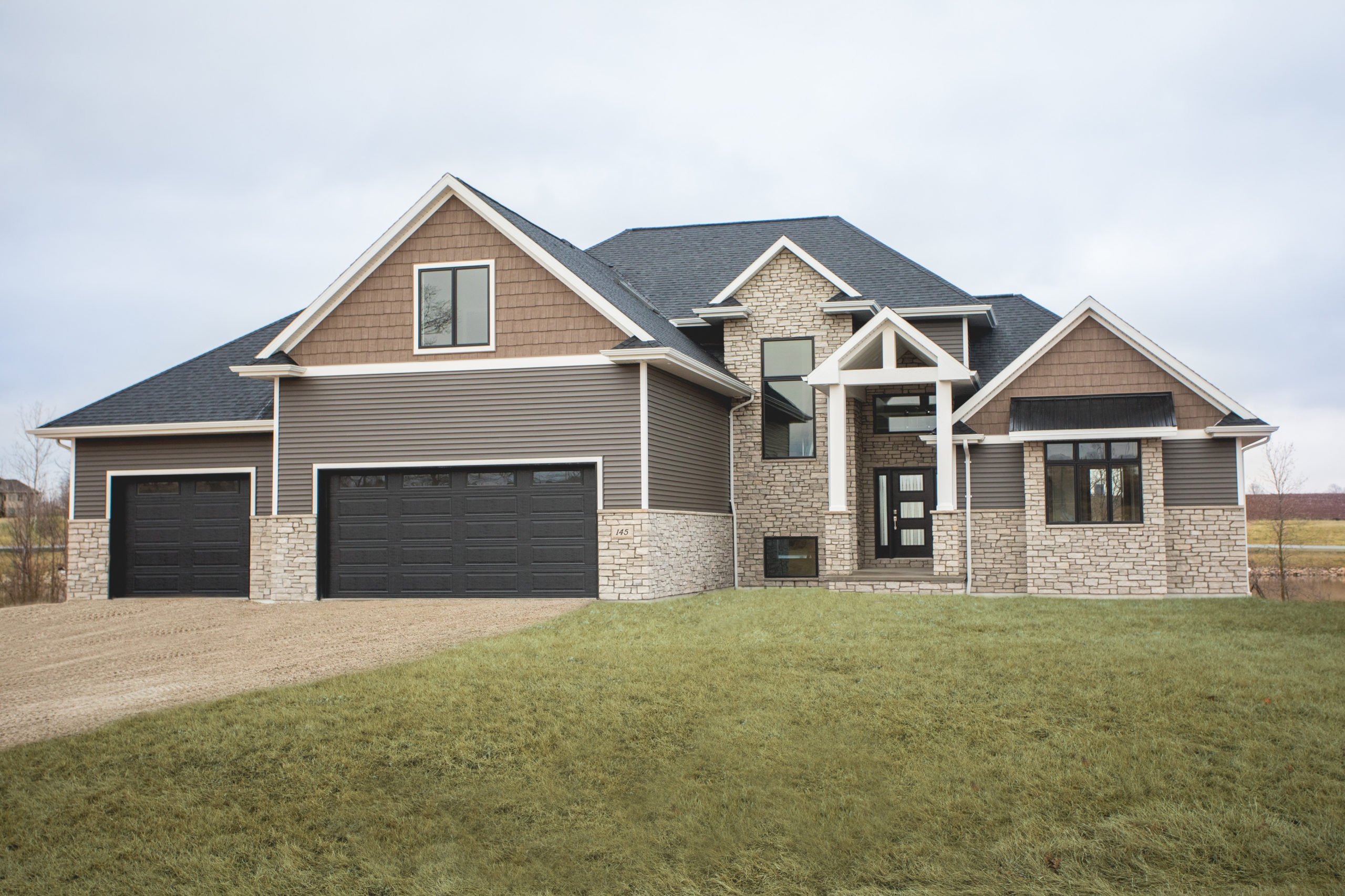 Front exterior view of The Mauermann custom home in Green Bay, WI by LeMense Quality Homes, Inc.