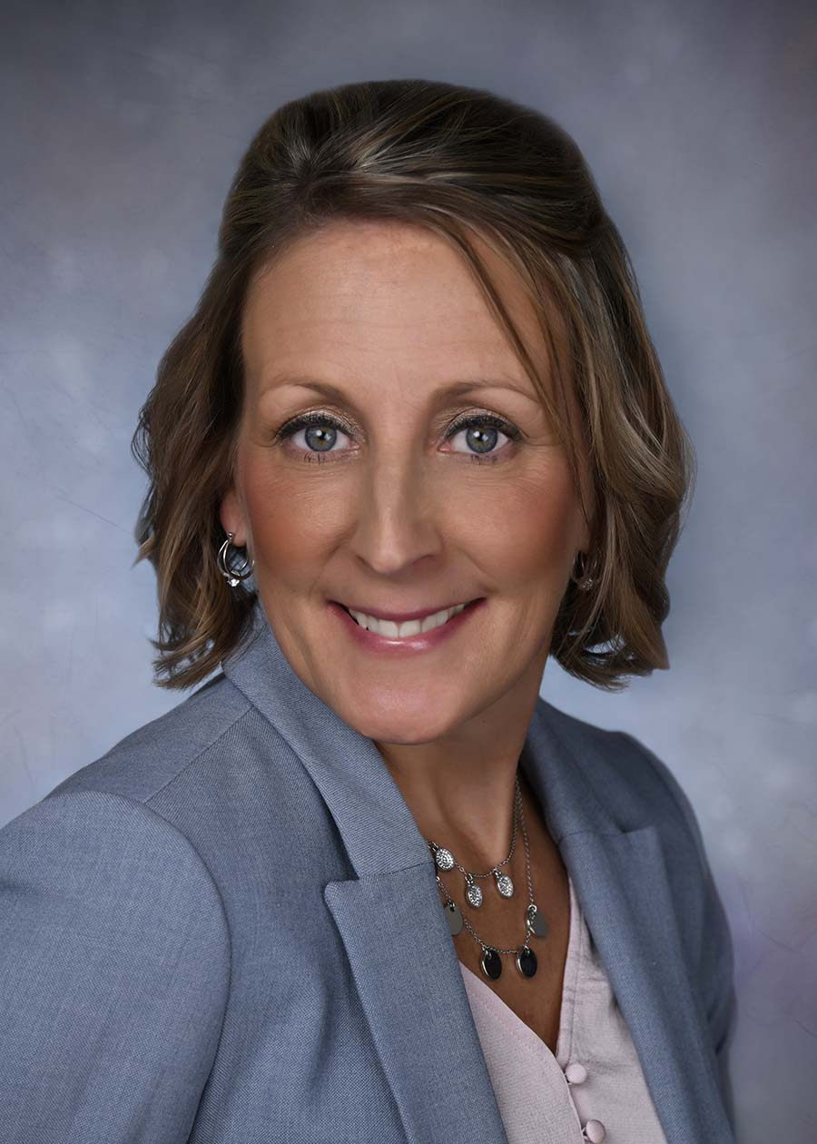 headshot of Shelly LeMense, custom home builder, realtor and interior designer in Green Bay, WI