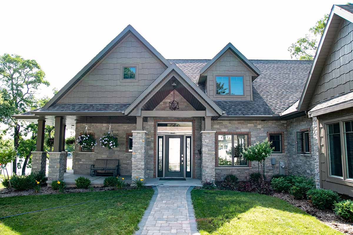 Front exterior view of The Eccles custom home in Green Bay, WI by LeMense Quality Homes, Inc.