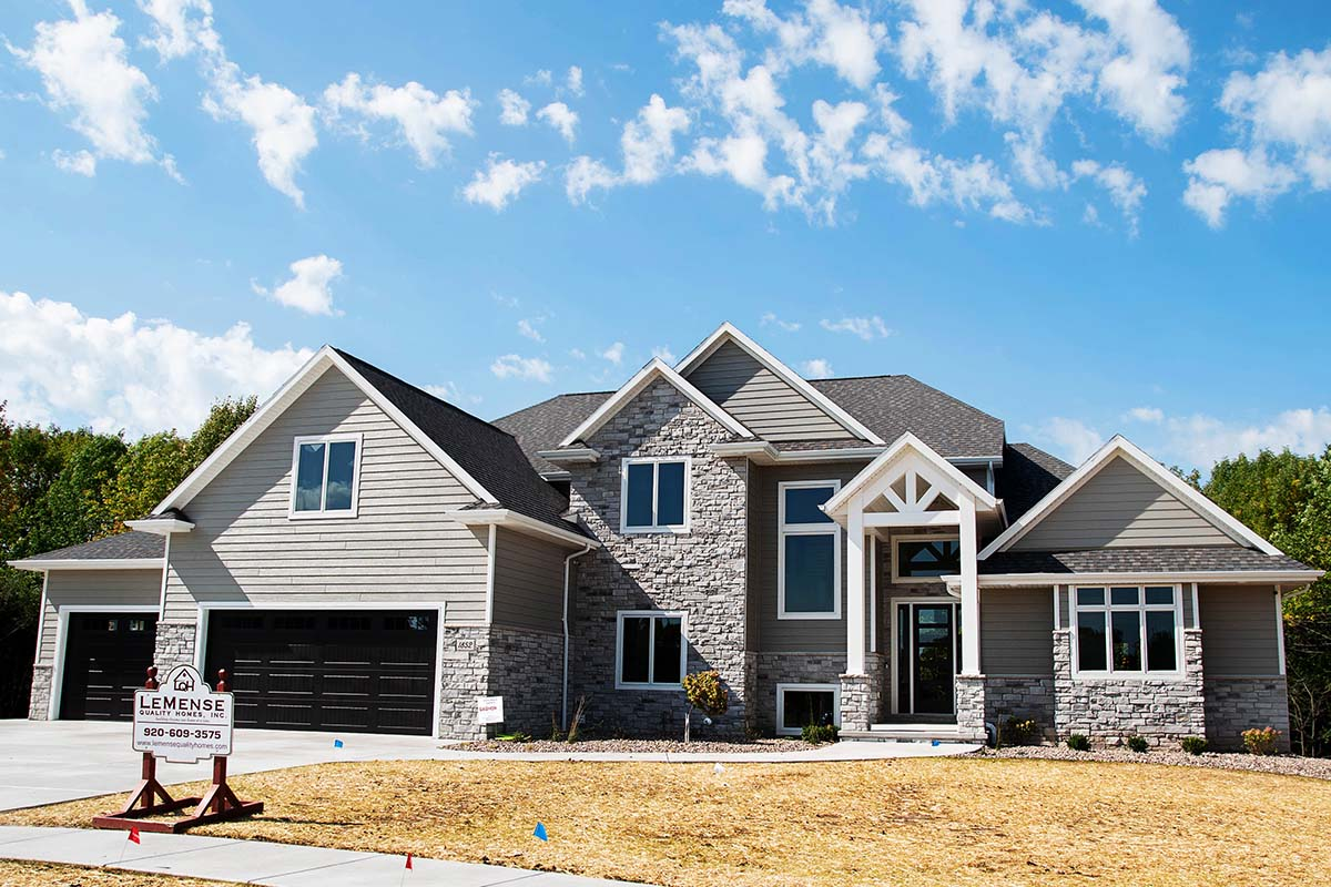 Front exterior view of The Titus custom home in Green Bay, WI by LeMense Quality Homes, Inc.