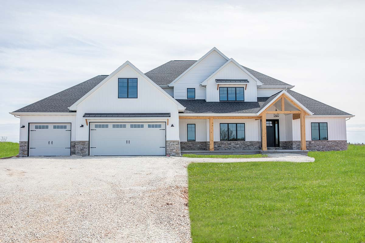 Front exterior view of The Herman custom home in Green Bay, WI by LeMense Quality Homes, Inc.